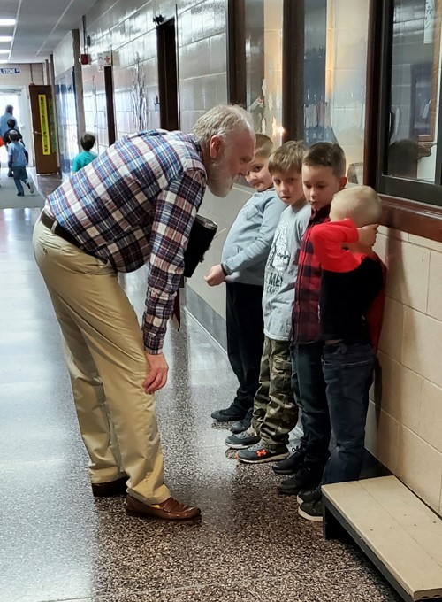 Mr Hayes talks to students in hallway