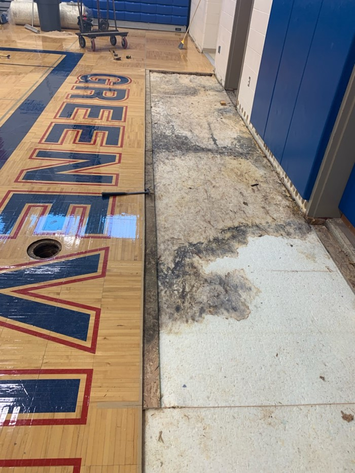 Water damage to Gym Floor at Middle School